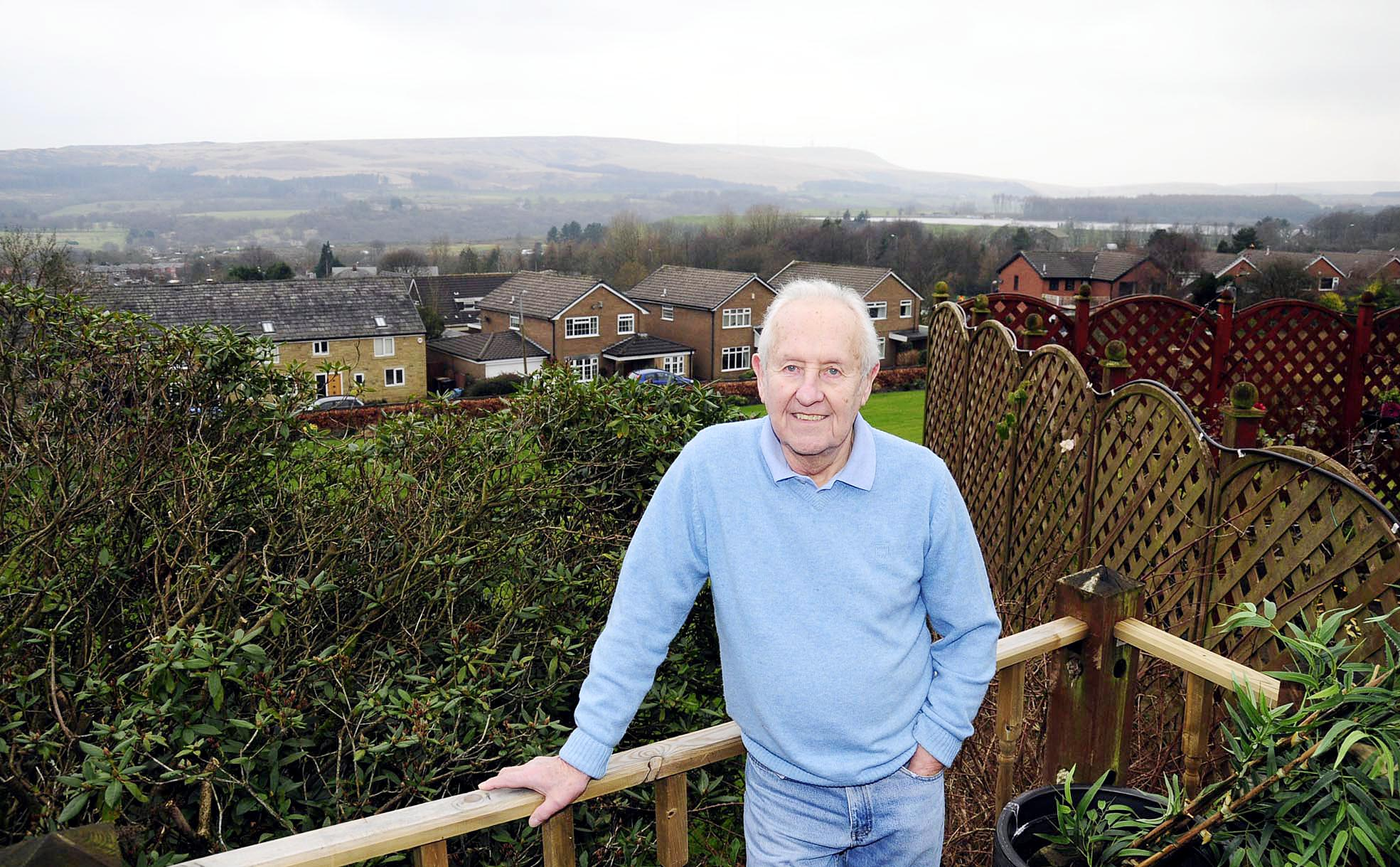 Brian Caswell enjoying the view from his new home on the outskirts of Bolton