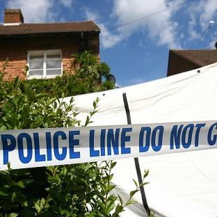This Is Lancashire: A man is being held after the bodies of two people were found at a house