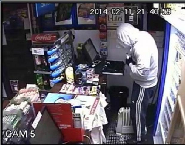 A CCTV image of the man in one of the robberies at the Mace Convenience Store in Brandlesholme Road