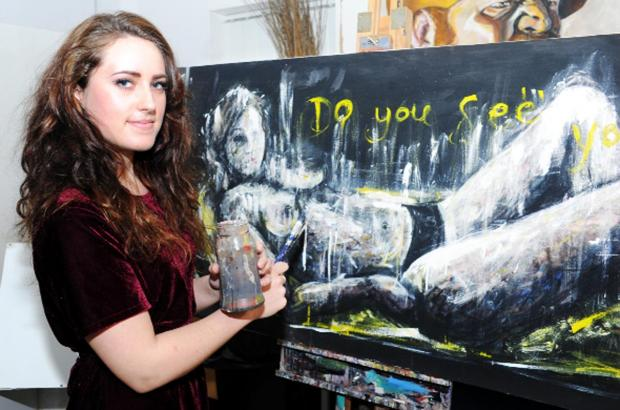 Hayley Darbyshire with one of her artworks