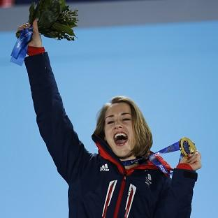 This Is Lancashire: Lizzy Yarnold celebrates during the medals ceremony at the Winter Olympics (AP)