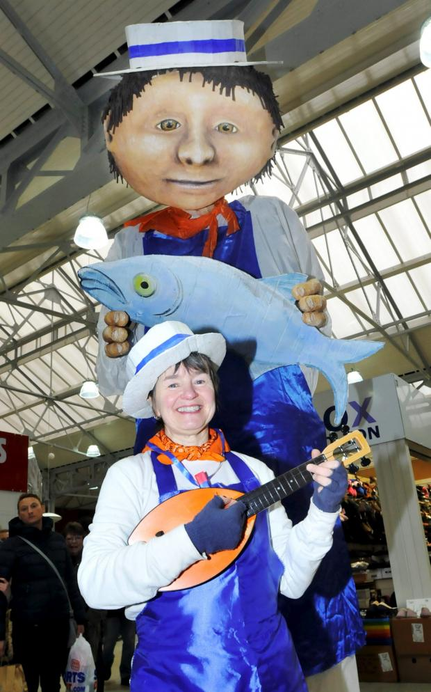 This Is Lancashire: Jimmy the Fishmonger and assistant Kathy Kim, of Thingumagjig Theatre, helped showcase all that was on offer in the revamped Bolton Market.