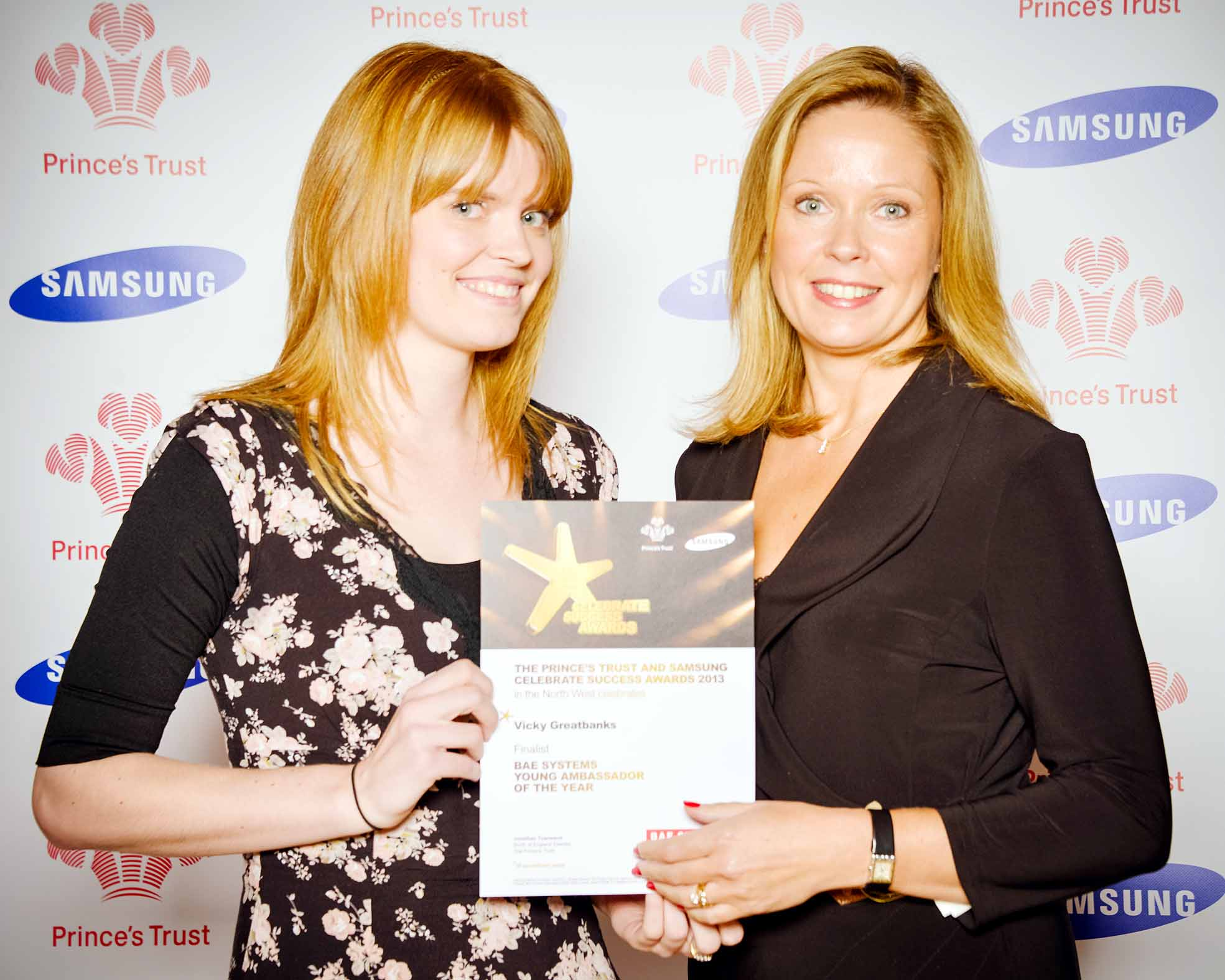 Vicky Greatbanks, left, receives her certificate from Catherine Lawler of sponsor BAE Systems