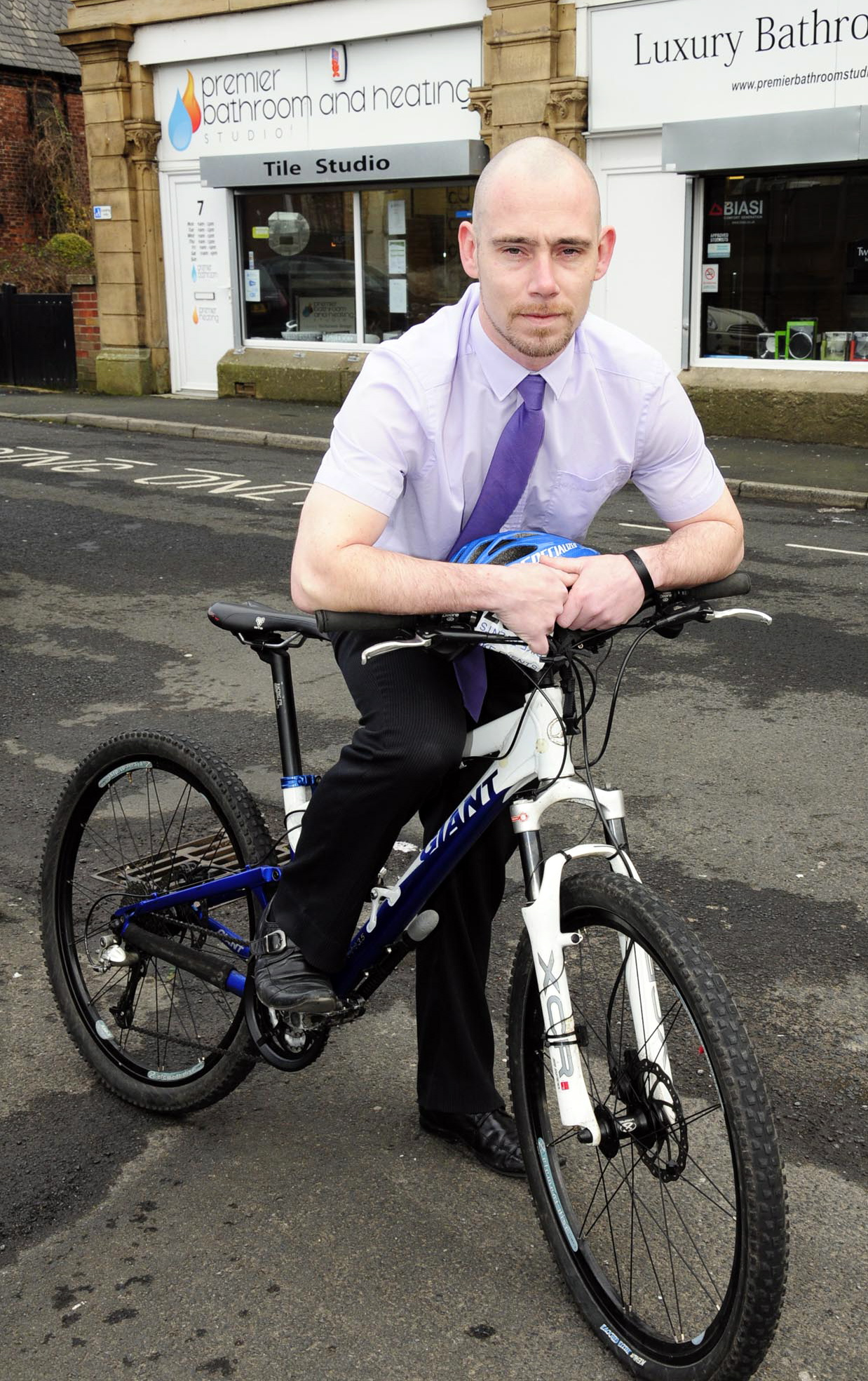 Stuart Badley gets on his bike to help