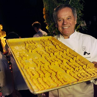 Chef Wolfgang Puck poses with chocolate Oscar statues, which will be served up at this year's Governors Ball