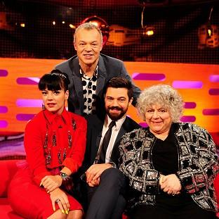 Presenter Graham Norton, back, with - from left - Lily Allen, Dominic Cooper and Miriam Margolyes