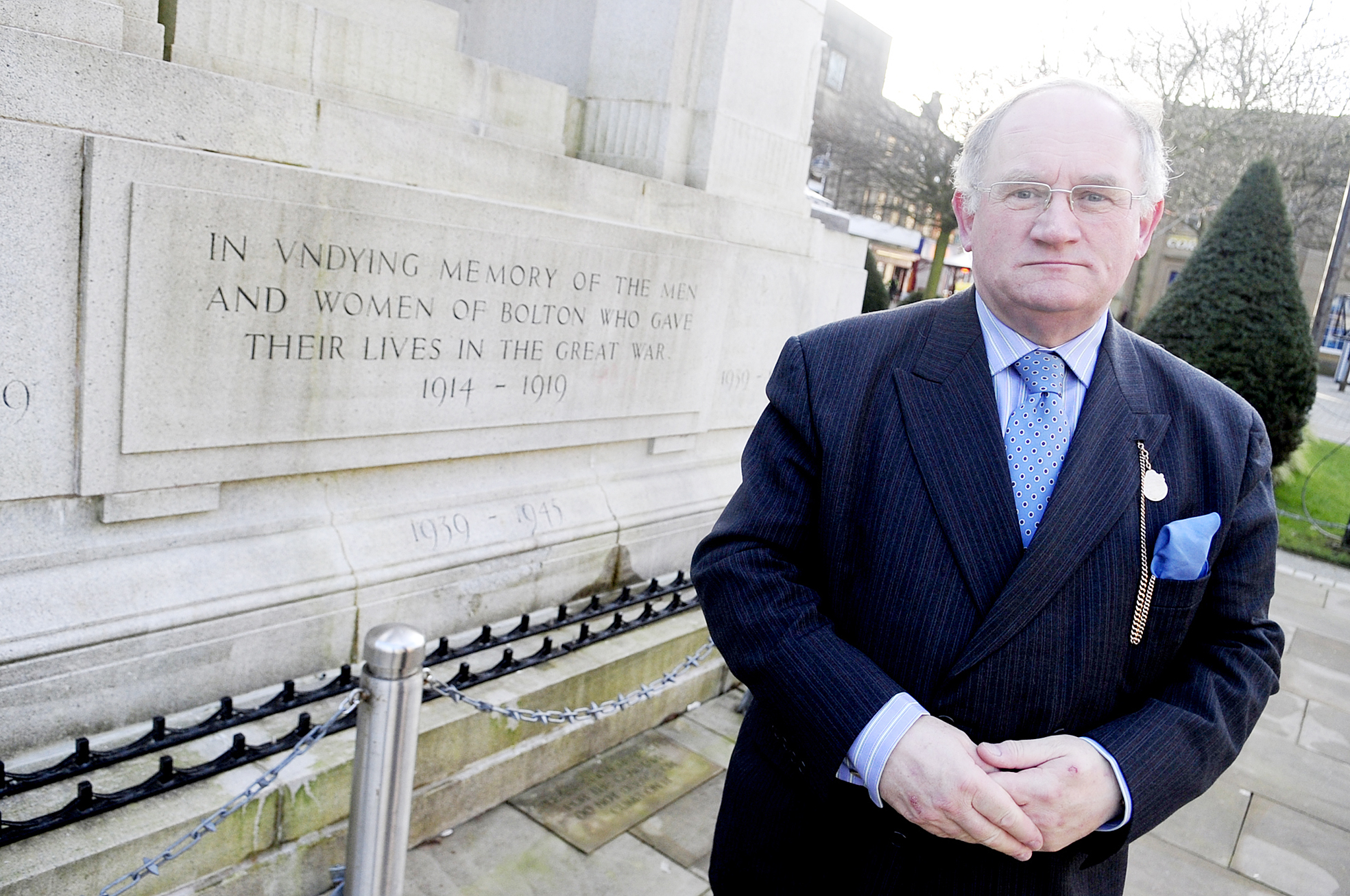 Cllr John Walsh, at the war memorial in Victoria Square, will be in charge of events commemorating the start of World War One