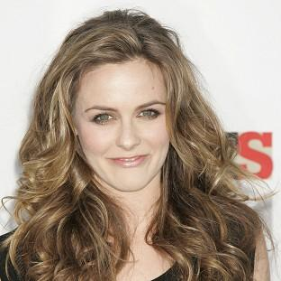 Alicia Silverstone gets distracted from her acting