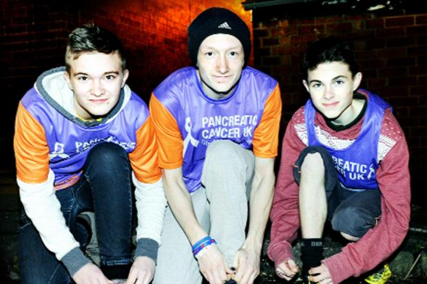 This Is Lancashire: John, left, and brother Anthony, right, together with friend Danny, are supporting the twins' dad