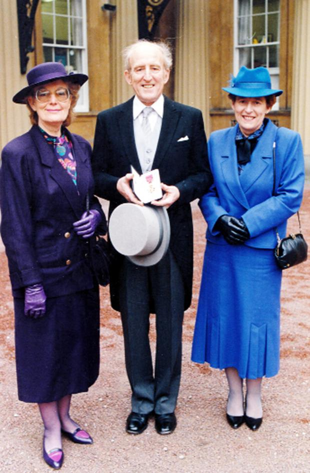 This Is Lancashire: Richard Warburton with his wife Lois, left, and sister Shirley when he received his OBE at Buckingham Palace in 1987