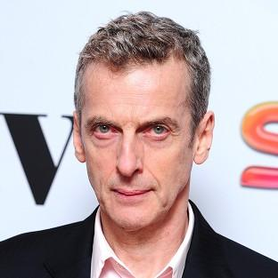 Peter Capaldi has been trying to keep warm while filming Doctor Who in Cardiff