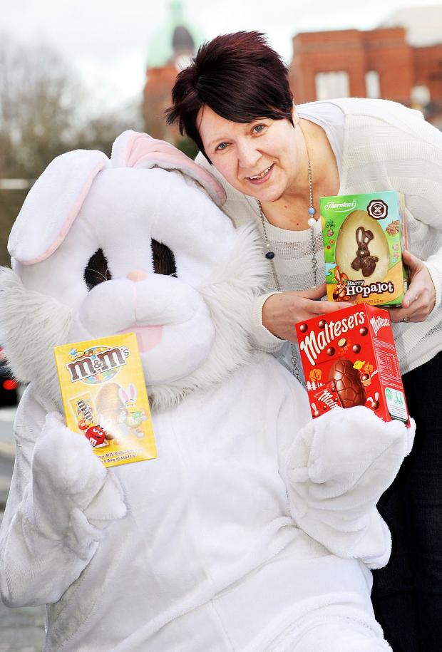 This Is Lancashire: Darts ace Lisa Ashton with Easter Bunny and donations at the start of the appeal at the Bay Mare pub