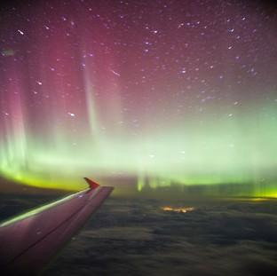 This Is Lancashire: A photo taken from a BA flight, chartered by Aerobility, a charity that gives people with disability the chance to fly, of the Northern Lights.