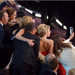 Kevin Spacey, Angelina Jolie, Julia Roberts, Brad Pitt, Jennifer Lawrence, Ellen Degeneres and Jared Leto join for the Twitter-busting selfie (AP)