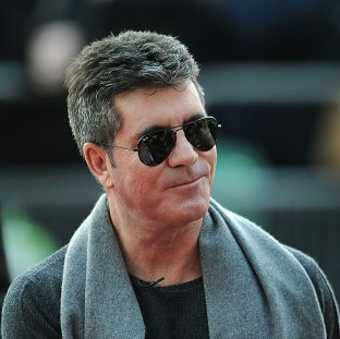 Simon Cowell has revealed he uses alcohol to get in the right frame of mind to get ideas for his shows