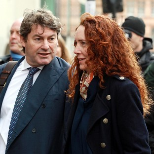 Former News International chief executive Rebekah Brooks and her husband Charlie Brooks arrive at the Old Bailey