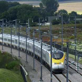 A Eurostar train travels through Ashford in Kent