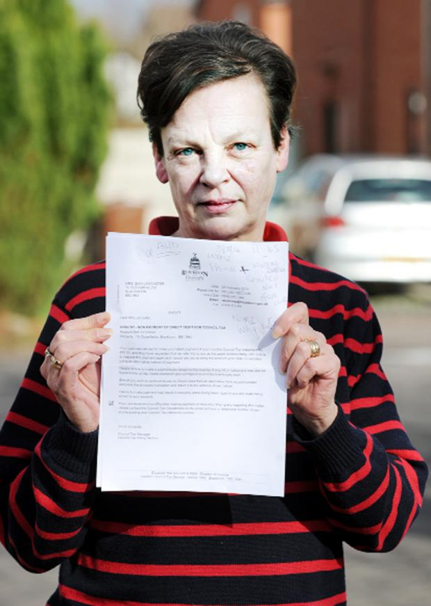 This Is Lancashire: Jean Lancaster with the letter about the bailiffs