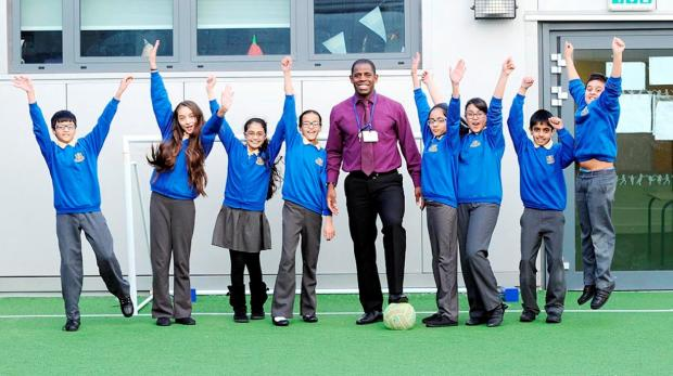 This Is Lancashire: Lenny Johnrose with pupils from St Silas