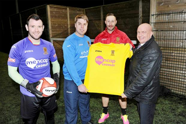 yellow: From left, Chorley FC keeper Sam Ashton, manager Garry Flitcroft, skipper Andy Teague and Andy Turner, from the Chorley Group, show off the new shirt