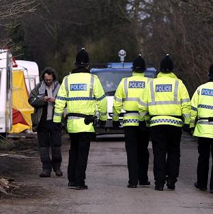 Police patrol a private road in Barton Moss, Greater Manchester where anti-fracking protestors have set up camp