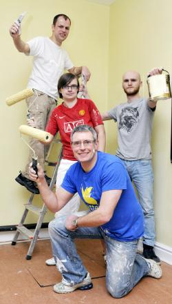 Co-op staff with paint brushes: David Ward on the ladder, Suzanne Ashurst, Phil Hindle and, front, Simon Taylor