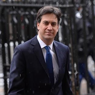 Ed Miliband used a visit to Camp Bastion to promise new legislation to protect the armed forces if Labour wins the 2015 general election