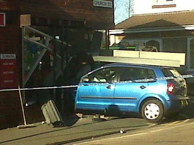 This Is Lancashire: A VW Polo smashed into the shop in Little Lever. Picture by Jonathan Parkes.