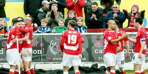 Stanley players celebrate their 3-1 win over League Two leaders Chesterfield on Saturday    Pictures: KIPAX
