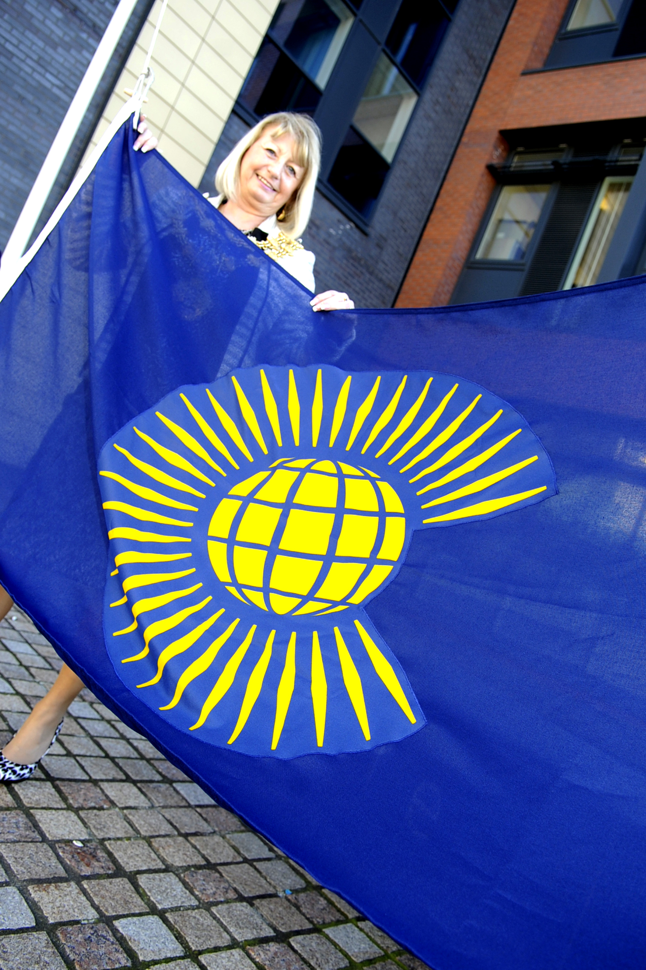 The Mayor of Bury Cllr Sharon Briggs with the Commonwealth flag