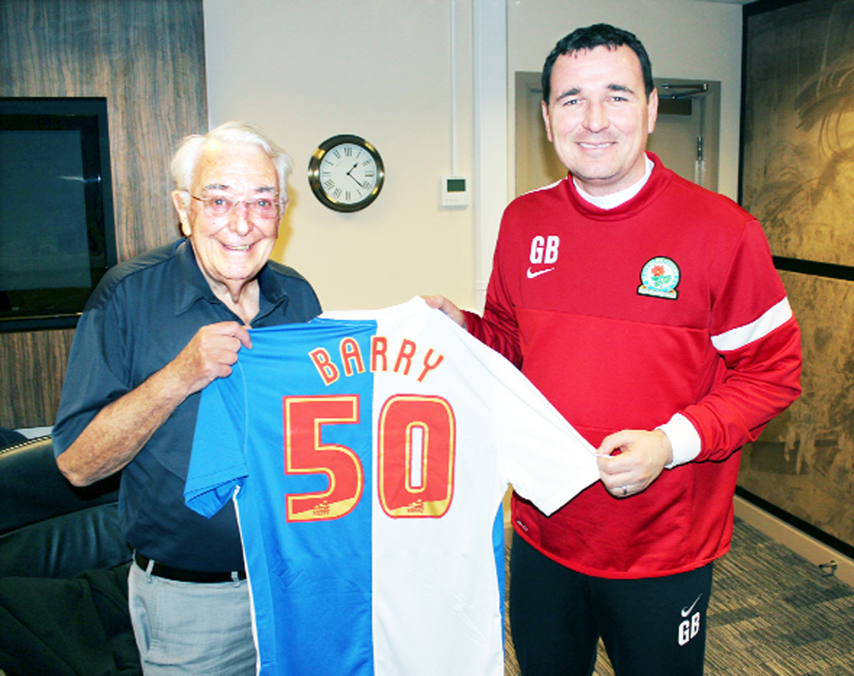 Barry Illsley is presented with the shirt by Rovers manager Gary Bowyer