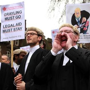 Lawyers from across the country marched on Westminster to protest against legal aid cuts and deliver a M
