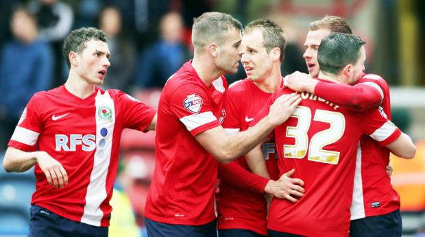 This Is Lancashire: Rovers celebrate at Huddersfield