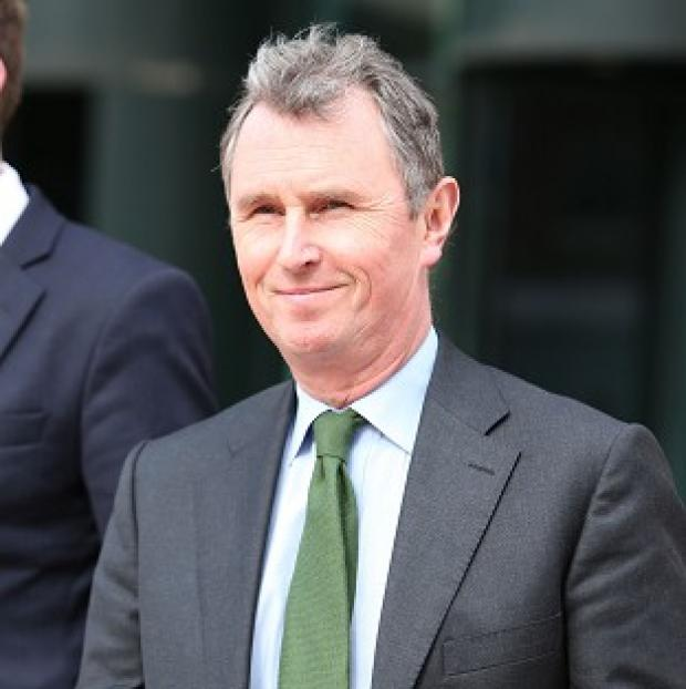 This Is Lancashire: Ex-Commons deputy speaker Nigel Evans outside Preston Crown Court where he faces nine charges of sexual offences against seven men