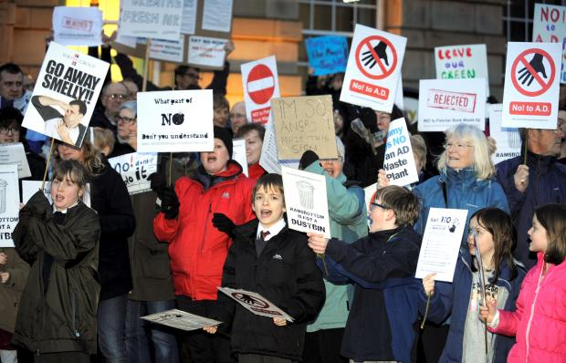This Is Lancashire: Protesters outside Bury Town Hall on Tuesday night
