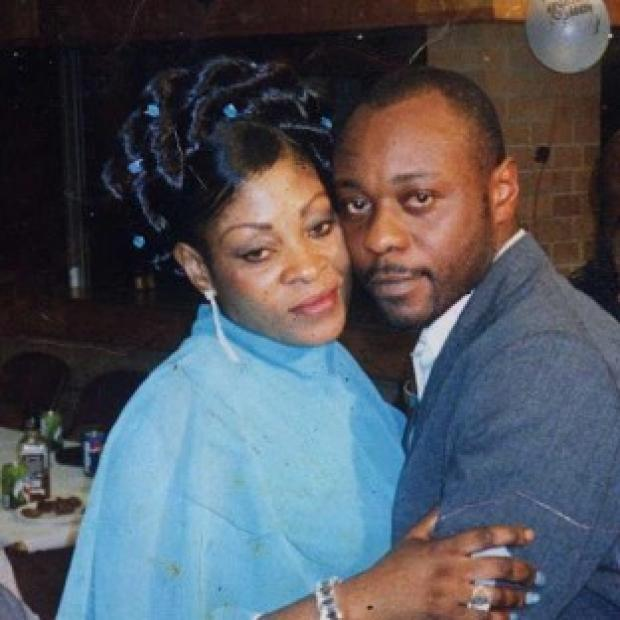 This Is Lancashire: Jimmy Mubenga, pictured with his wife Adrienne Makenda Kambana, died while being restrained on a flight back to his native Angola