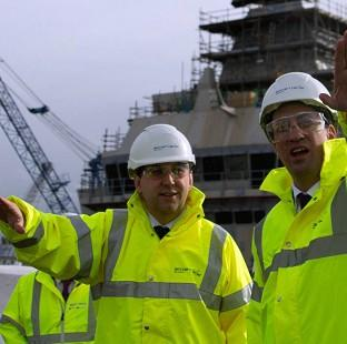 This Is Lancashire: Labour leader Ed Miliband (right) and Thomas Docherty during a visit to the Rosyth Dockyard at Dunfermline, Fife