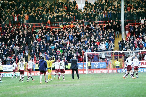 Burnley salute their fans after the game at Charlton