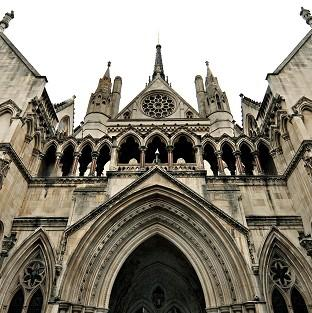 A High Court judge has praised a woman with drink and drug problems who agreed an adoption plan fo