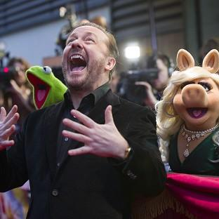 Kermit the Frog, Ricky Gervais, Miss Piggy and Constantine at the celebrity screening of Muppets Most Wanted at the Curzon Mayfair in central London