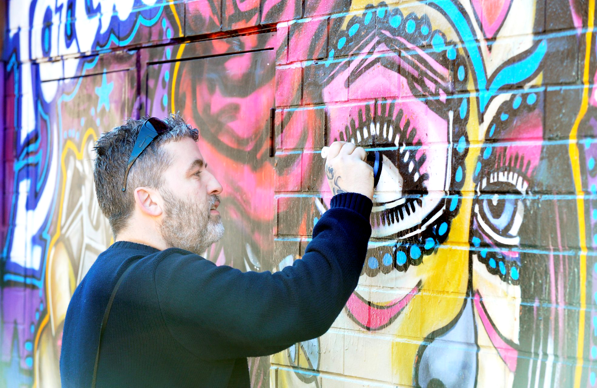 Graffiti artist repairs his own work - after it was targeted by vandals