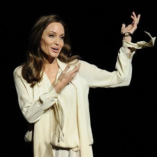 Angelina Jolie introduces a trailer for her film Unbroken (Invision/AP)