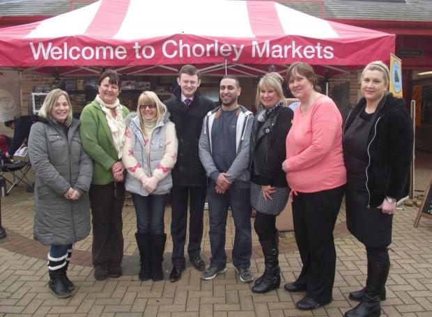 NEW STALLS: Coun Peter Wilson (centre) with new traders at Chorley Covered Market