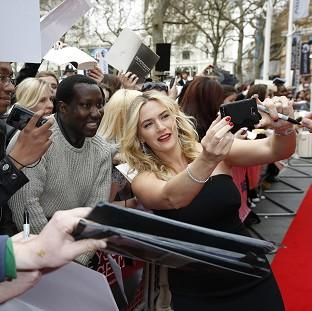 Kate Winslet poses for pictures with fans at the European premiere of the film, Divergent, at the Odeon Leicester Square, central London.