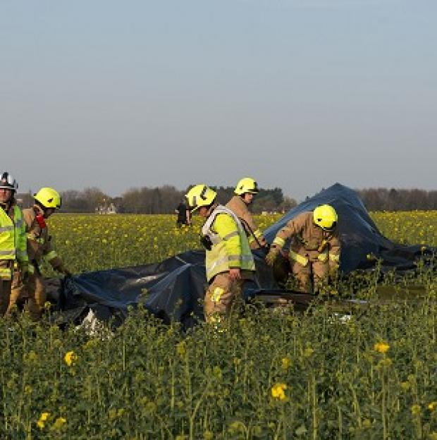 This Is Lancashire: Emergency services at the scene of a plane crash near Ongar, Essex, where a Yak 52 aircraft's pilot and passenger, both from Essex, were killed after the plane flew out from North Weald airfield.