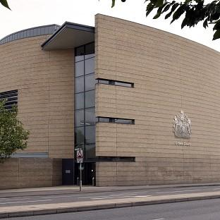 Five men are standing trial at Cambridge Crown Court accused of trafficking and ra