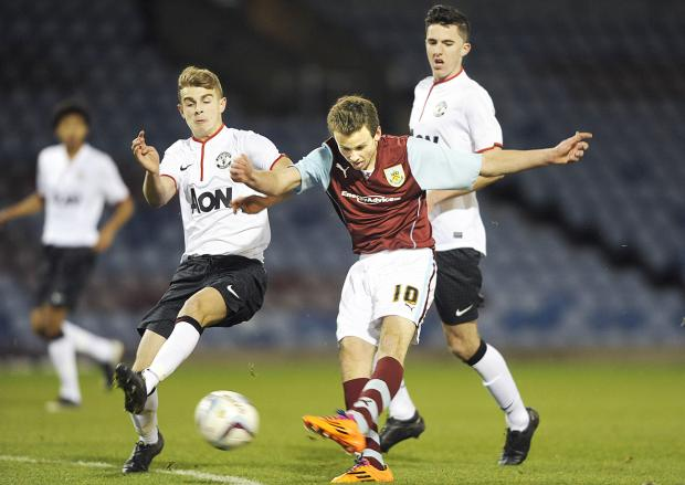 Burnley's Jamie Frost in action during this season's FA Youth Cup defeat to Manchester United