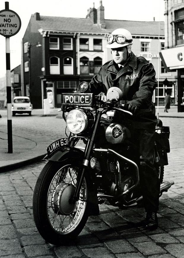 This Is Lancashire: Bolton policing — on a motorbike