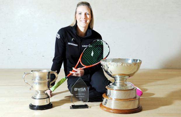 Three's a crowd! Chorley's squash star Laura Massaro shows off her three trophies for the first time since landing home
