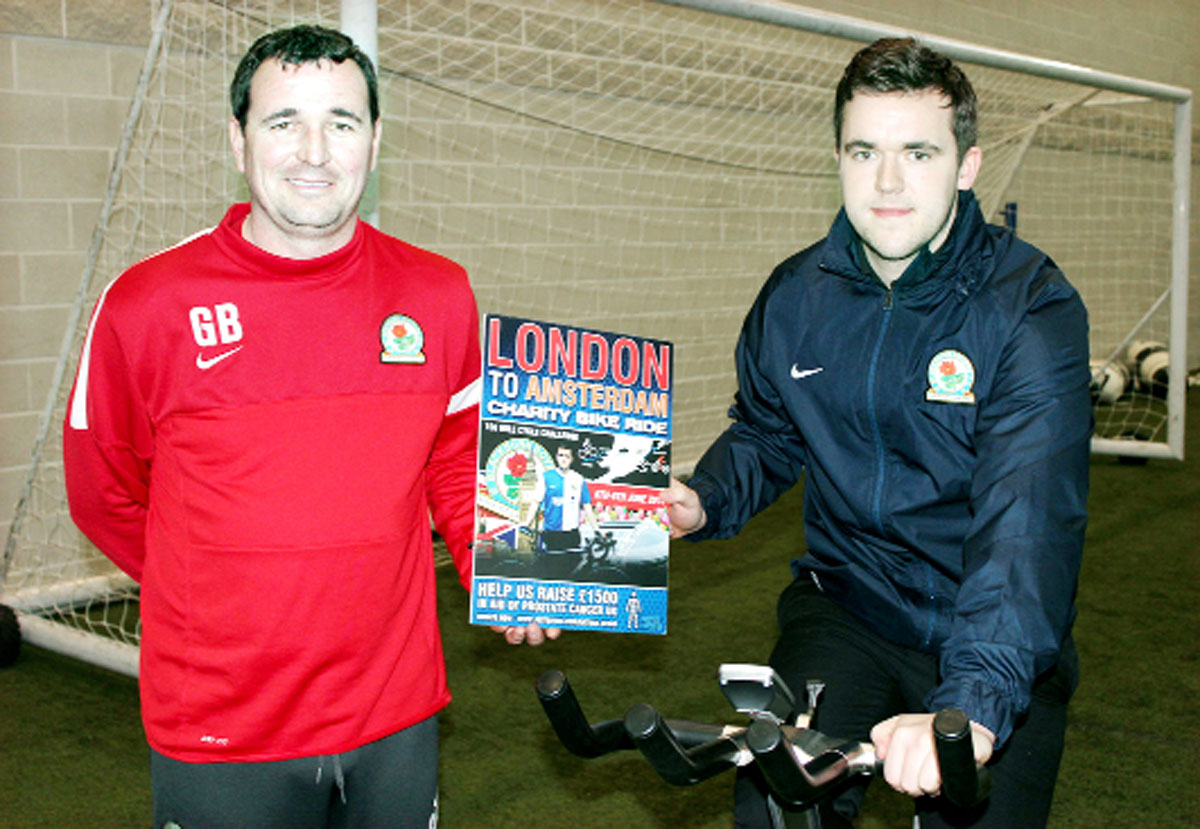 Nathan Regan, right, with Blackburn Rovers manager Gary Bowyer as he prepares to cycle to Amsterdam to raise cash for Prostate Cancer UK